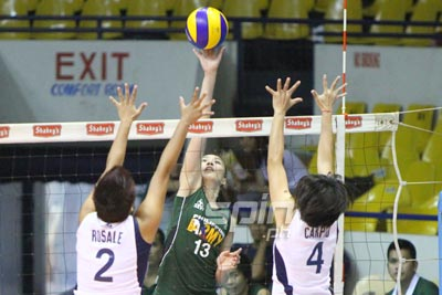 Army's Rachel Daquis tries to score against two Navy defenders. Photo by Jomar Galvez