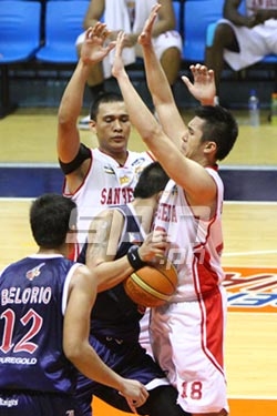 Letran's Jame Cortes gets sandwiched by two San Beda defenders. Photo by Jomar Galvez