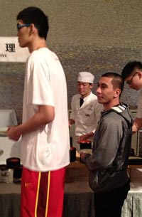 A photo from Larry Fonacier's Twitter account shows 5-7 LA Tenorio being dwarfed by a Chinese player as they line up at the buffet table. Photo from @findingheaven12