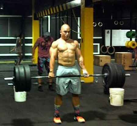 Coach Anton pumps iron as part of the WOD.