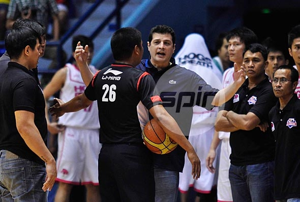 Hog's Breath coach Caloy Garcia argues with a referee and is called for a technical foul. Photo by Dante Peralta
