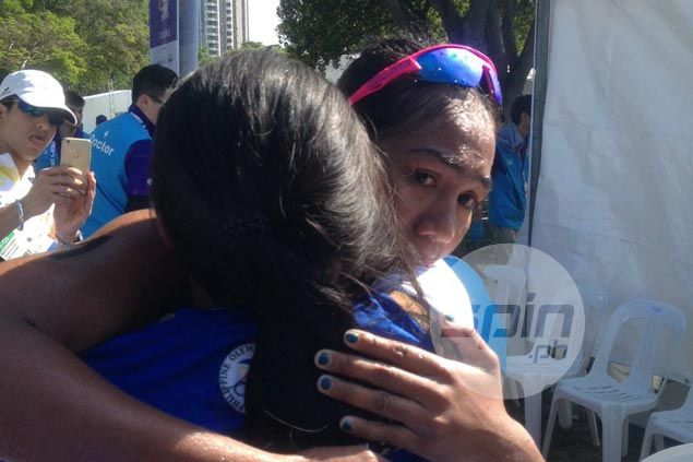 A warm embrace greeted Claire Adorna after winning the women's triathlon gold. Reuben Terrado