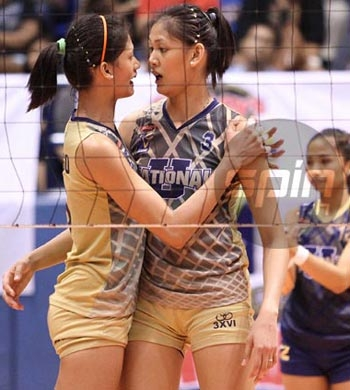 Sisters Dindin and Jaja Santiago and the NU Lady Bulldogs try to end the DLSU Lady Spikers' reign. Photo by Jerome Ascano