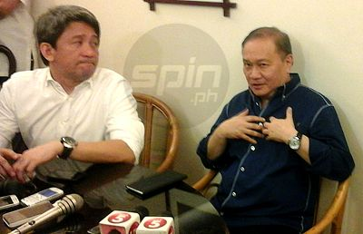 Manny V. Pangilinan in an impromptu press conference with PLDT executive vice president Ariel Fermin. Photo by Reuben Terrado