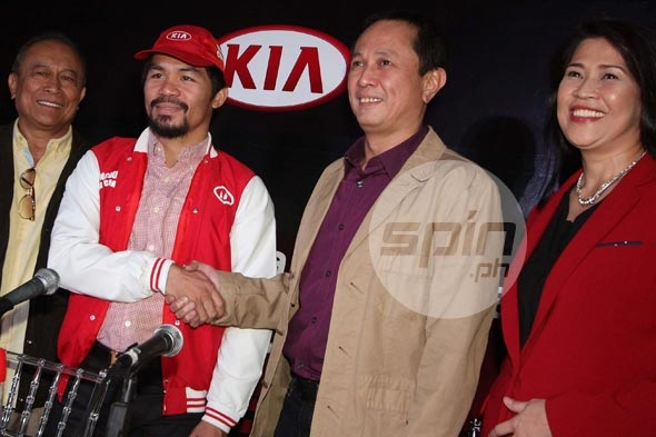 Newly named Kia head coach Manny Pacquiao presented by, from left, Columbia Autocar Corp. chairman Jose Alvarez, PBA commissioner Chito Salud, and Columbia president Ginia Domingo. Jerome Ascano