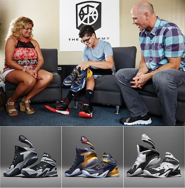 Sixteen-year old Matthew Walzer receives the first pair of the Zoom Soldier 8 Flyease which he helped design from Nike designer Tobie Hatfield