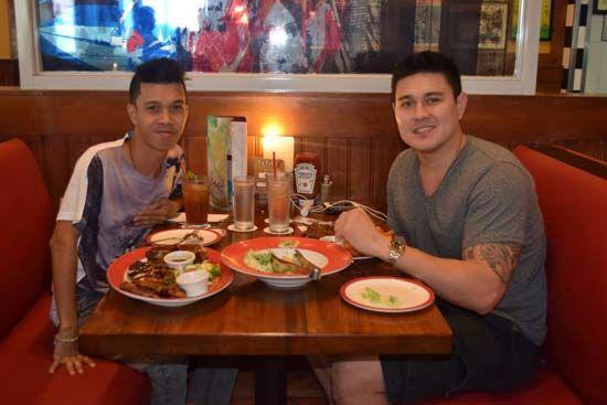 Jondan Salvador and No. 1 fan Ezekiel Nitura share a meal.