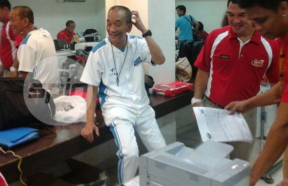 San Mig ballboy Junjun Rillo is ribbed by mediamen inside the press room. Photo by Reuben Terrado
