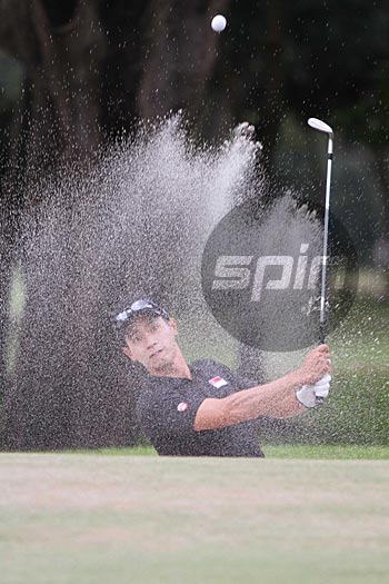 Jerome Ng finds the bunker on the approach to the final green and winds up with a bogey. Photo by Jerome Ascano