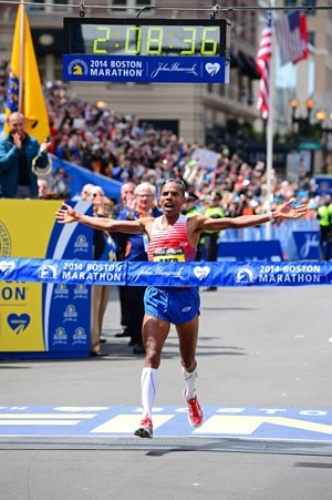Meb Keflezighi crosses the finish line in his Skechers GORun performance shoes.