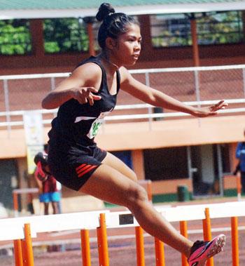 Melissa Escoton rules the girls 14-15 division 100-m hurdles.