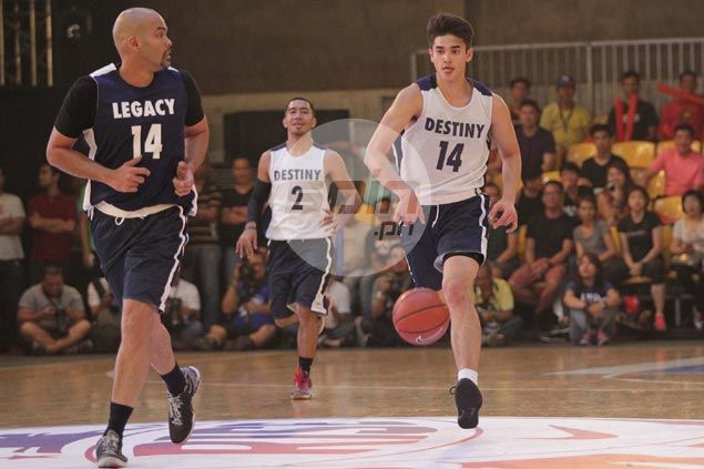 Benjie Paras tries to keep pace with son Kobe during a fastbreak play. Jerome Ascano