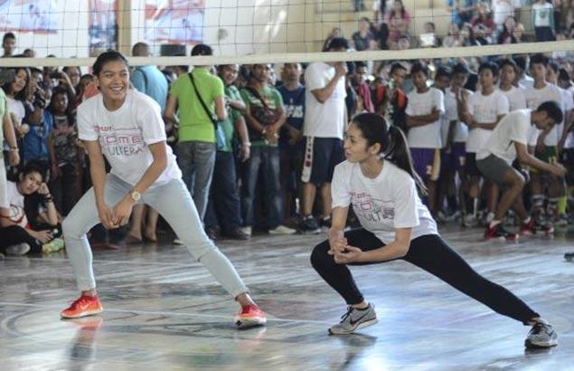 Popular volleybelles Alyssa Valdez and Denden Lazaro share a moment.