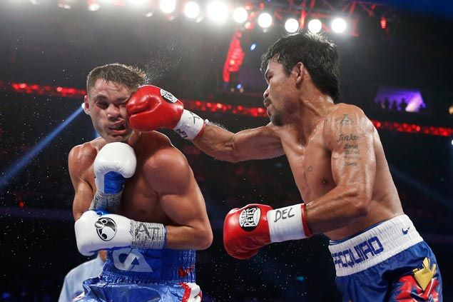 Chris Algieri's pretty face left distorted by a solid right from Manny Pacquiao. AP