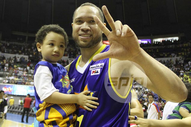 Three cheers for Kelly Williams as he celebrates with his son Charlie after the Texters' third successive all-Filipino championship.  Jerome Ascano