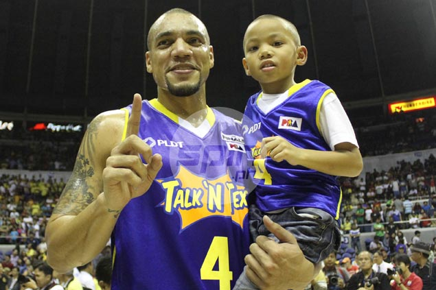 Undersized big man Harvey Carey and his 'mini-me' celebrate on the hardcourt.  Jerome Ascano
