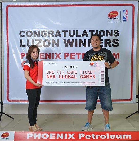Phoenix Petroleum Brand and Marketing Manager Celina Matias awards the NBA Global Games Philippines 2013 ticket to Mr. Efren Bercasio Jr. on October 1, 2013 at Phoenix office in Taguig. Mr. Bercasio will watch the Houston Rockets and Indiana Pacers on October 10 at the SM Mall of Asia Arena as prize in the Gas Up, Match Up Promo. The prize includes hotel accommodation and travel allowance of P10,000. Phoenix Petroleum drew 50 lucky winners to the promo as part of its partnership with NBA.