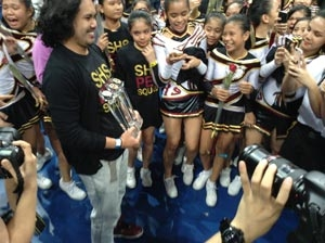 SHS Pep Squad coach Randell San Gregorio proudly holds the three trophies his teams won in Day of the National Cheerleading Championships
