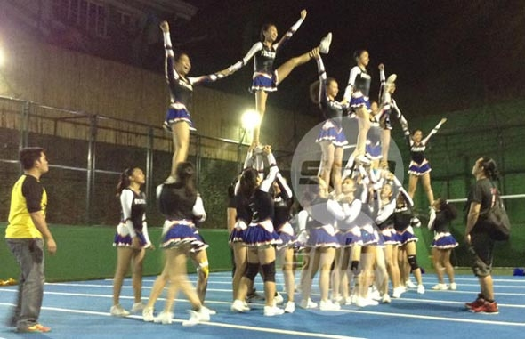 Team Pilipinas practicing their pyramid as coaches look on.