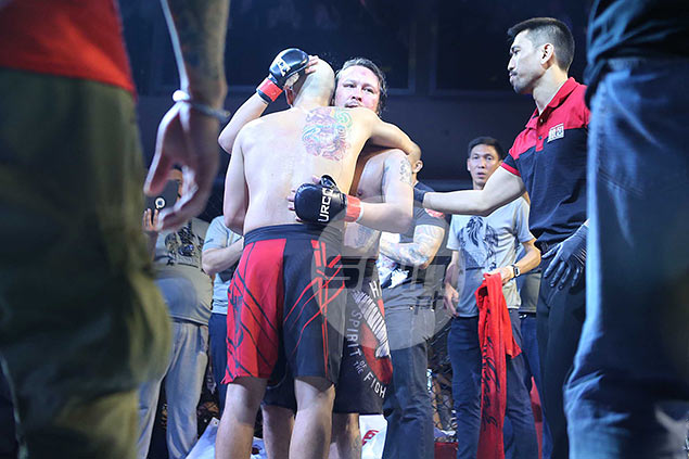 Kiko Matos and Baron Geisler hug it out at the end of the one-off URCC fight.