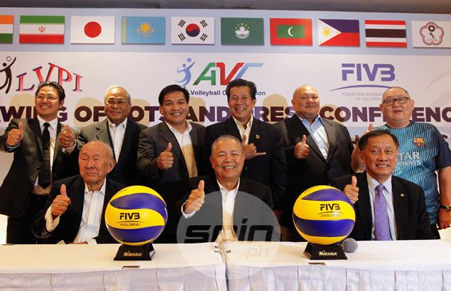 top volleyball officials give the thumbs-up after the drawing of lots for the tournament. Fernando Solo