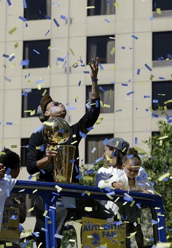 Golden State Warriors guard Stephen Curry is joined in the parade by daughter Riley and wife Ayesha. AP