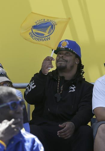 Seattle Seahawks running back Marshawn Lynch joins his hometown in celebrating the Golden State Warriors title win. AP