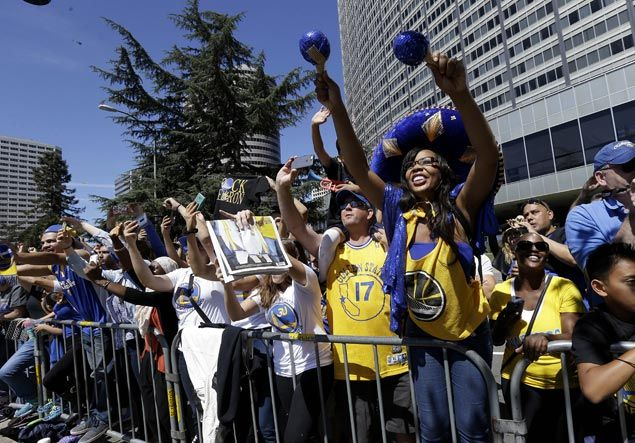 Golden State Warriors ride along during a parade and rally for winning the NBA championship in Oakland. AP