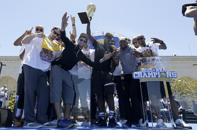 The team members pose for pictures together as they celebrate the title win with the fans. AP