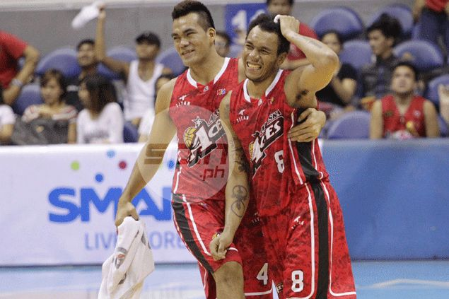 Calvin Abueva and Vic Manuel celebrate Alaska's huge win over Barako Bull