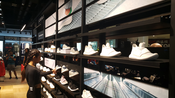 adidas HomeCourt Shoebase section featuring a lineup of Stan Smiths and Superstars.