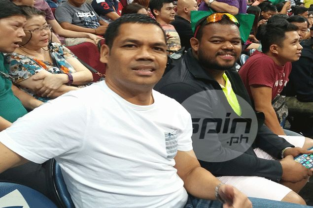 Former Ginebra cager Peter Aguilar watching son Japeth's game at Mall of Asia Arena