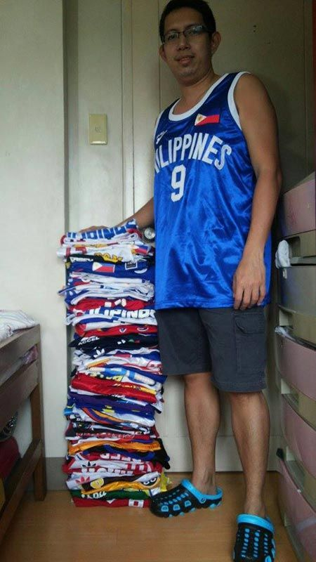 Alvin Giolagon, 39, with some examples of his jersey collection.