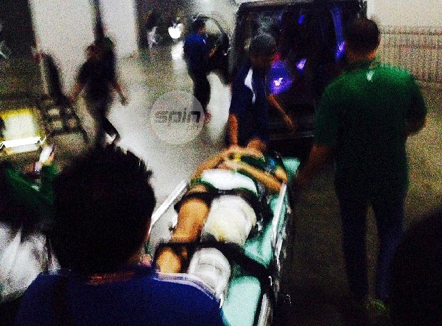 Ara Galang is wheeled to a waiting ambulance. Reuben Terrado