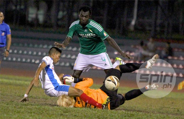 Ricardo Becite of Army gets tangled up with Sta. Lucia goalie Dong Hyun Kim as Doumbia Abdoulaye looks on. Jomar Galvez