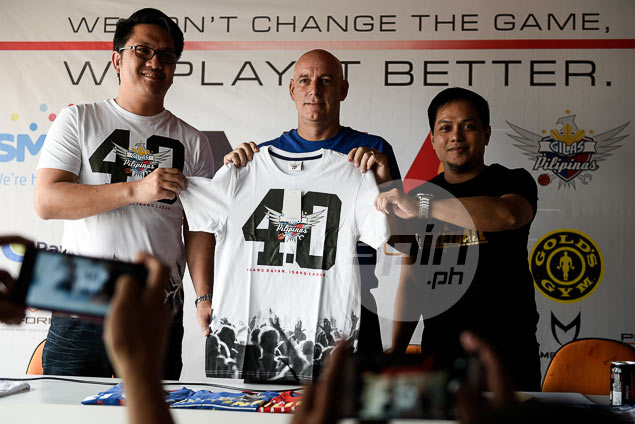 487c2f76dac5 National coach Tab Baldwin and Melmac Sports chief executive officer Mel  Macasaquit present the authentic Gilas Pilipinas shirts. Jaime Campos