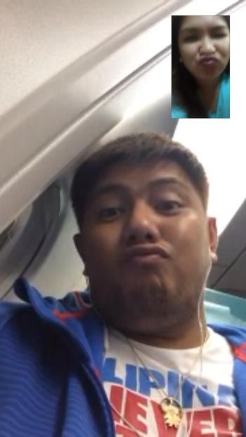 Beau Belga with some Facetime with wife Quennie in the plane bound for Wuhan, China.
