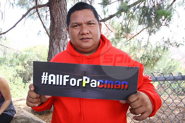 Buboy Fernandez holds up #AllForPacman hashtag. Jerome Ascano