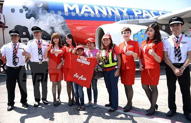 Catherine Cabardo and son James Christian join AirAsia crew members. Jaime Campos