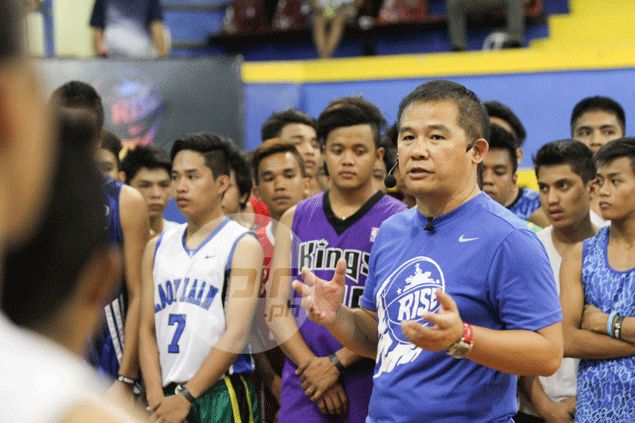 Former national coach Chot Reyes personally supervises the Nike Rise tryouts at the San Andres Gym in Manila. Czar Dancel