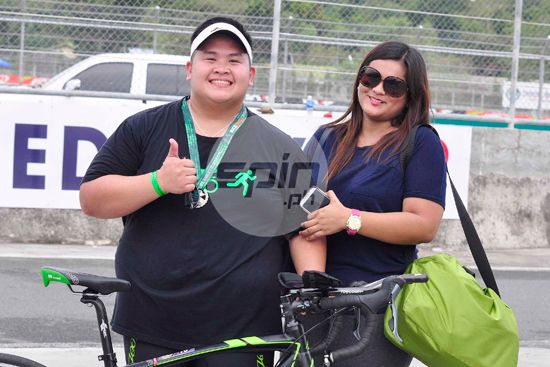 Christian Gacias with his girlfriend, Tisha Alcantara, is all smiles after finishing his first duathlon at the Clark International Speedway.