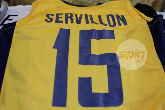 Servillon's JRU jersey is placed atop his casket. Jerome Ascano
