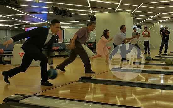 Former bowling champ CJ Suarez leads SM Lifestyle and Entertainment and Philippine Bowling Congress officials during the ceremonial ball of the 2015 Millionaires Cup at the Mega Fashion Hall