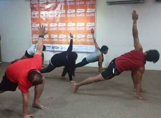 Participants doing yoga as part of Session 3