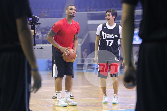 Damian Lillard spends court time with PBA player Chris Tiu in his second Manila visit.