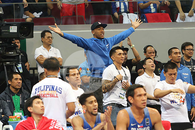 One of the last cuts of Gilas, fan favorite Calvin Abueva shows he and Jimmy Alapag  are fans themselves behind their team's bench. Jerome Ascano & Jaime Campos