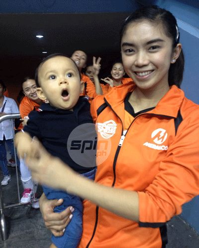 Baby-sitting duties for Fille before a game. Mei-Lin Lozada