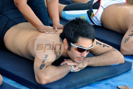 Actor Gerald Anderson enjoys a massage during the recovery period after his 1st triathlon in Subic.