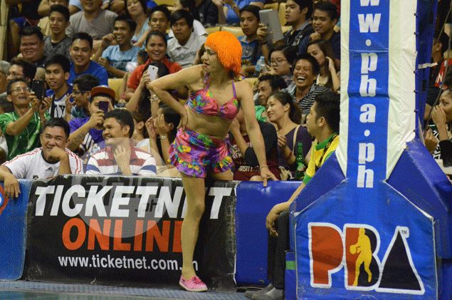 A fan provides comic relief amid the tension in the game. Freddie Dionisio