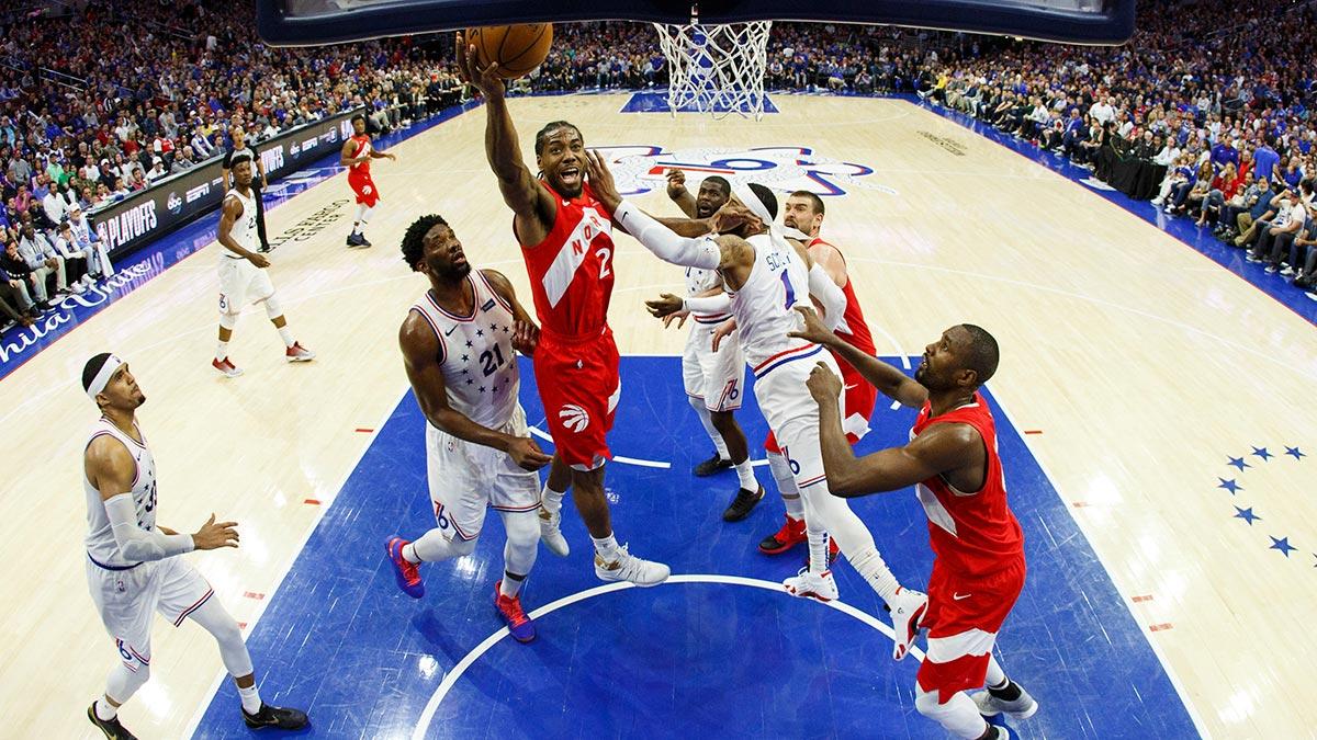 Leonard scores 39, Raptors beat 76ers to tie series